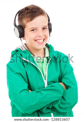 Young casual boy listening to music on headphones against white background - stock photo
