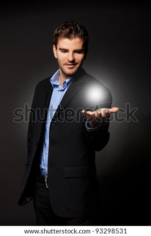 young casual business man holding the answer to all the problems - stock photo