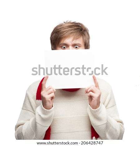 young casual caucasian couple in red scarf and hat holding sign with funny expressions - stock photo