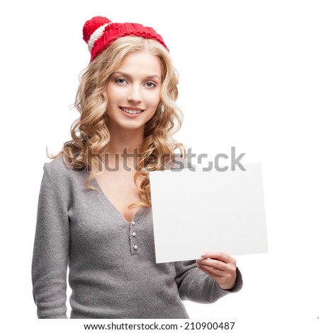 young casual caucasian woman holding sign isolated on white - stock photo