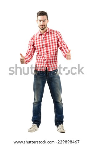 Young casual guy in plaid shirt with thumbs up gesture on both hands. Full body length portrait isolated over white background. - stock photo