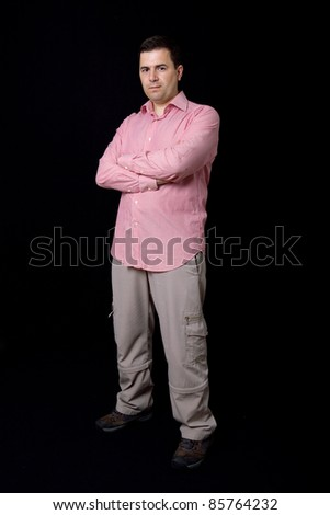 young casual man full body on a black background - stock photo