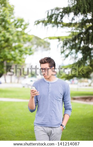 Young Casual Man Having Problems With Smart Phone. - stock photo