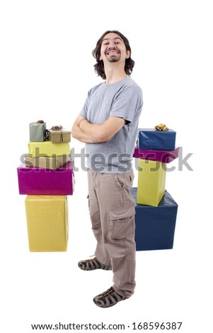 young casual man holding gifts, isolated  - stock photo