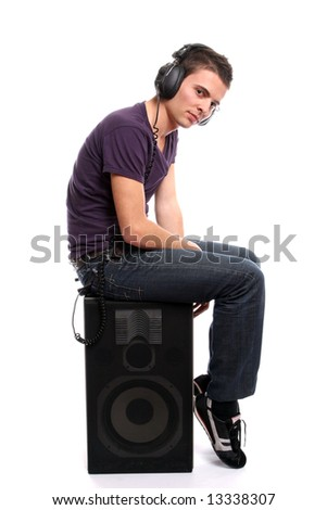 Young casual man listening to music, isolated in white background - stock photo
