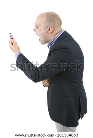 young casual man mad and surprised at the phone, isolated - stock photo