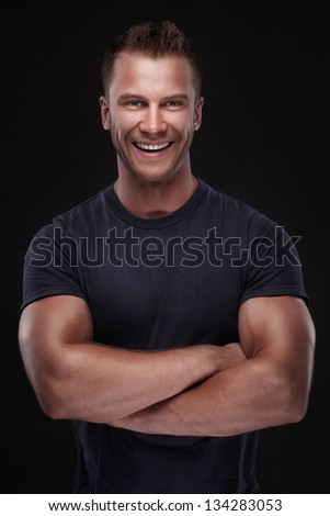 young casual man portrait isolated on black background - stock photo