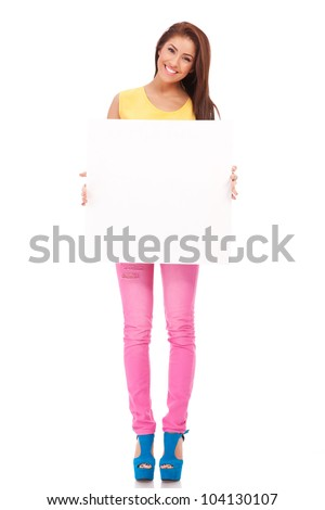 young casual woman choosing you by pointing to the camera on white background - stock photo