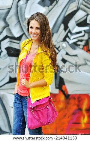 Young casual woman in colorful clothes outdoor portrait  - stock photo