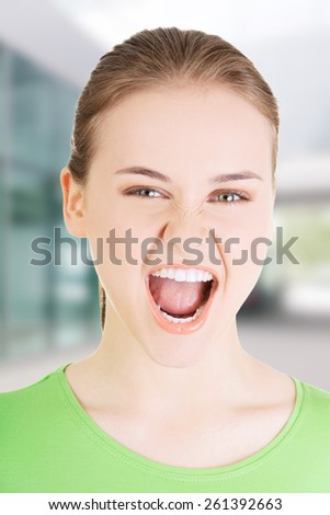 Young casual woman screaming with anger. - stock photo