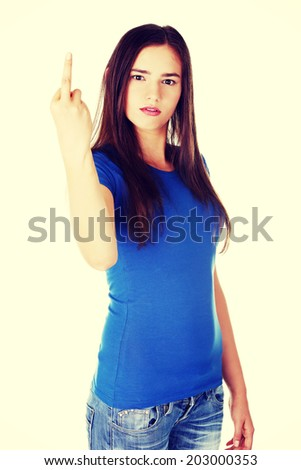 Young casual woman showing middle finger. Isolated on white. - stock photo
