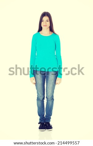 Young casual woman standing. Isolated on white. - stock photo