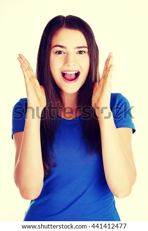 Young casual woman student expresses shock, surprise. - stock photo