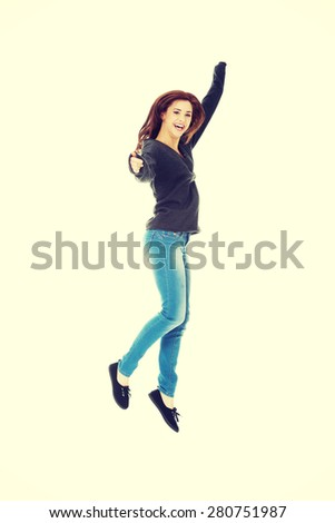 Young casual woman, student jumping in air. - stock photo