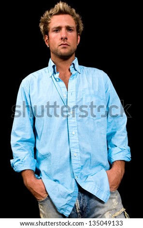 Young, Caucasian, blue eyed, blonde male shot on a black background - stock photo
