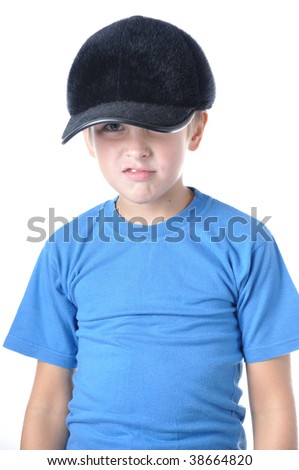 Young caucasian boy wearing baseball cap over white - stock photo