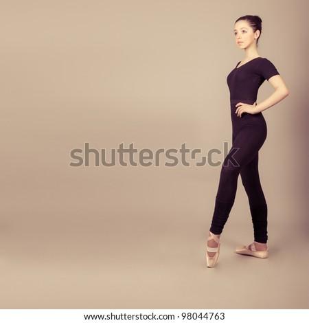Young caucasian brunette ballerina girl - stock photo