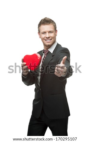 young caucasian business woman in black suit holding red heart isolated on white - stock photo