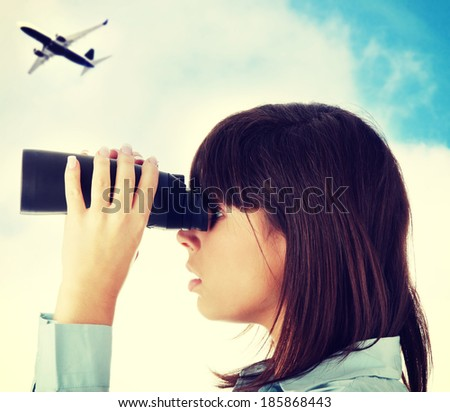 Young caucasian business woman looking throught binocular  - stock photo
