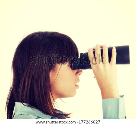 Young caucasian business woman looking throught binocular isolated on white background - stock photo