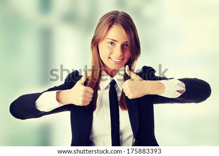Young caucasian business woman thumbs up  - stock photo