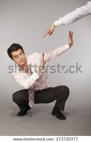 Young caucasian businessman defeated and beaten up - stock photo