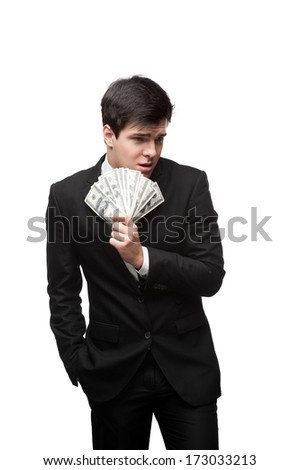 young caucasian businessman in black suit holding money isolated on white - stock photo