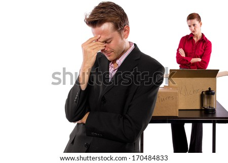 young caucasian couple breaking up and moving out - stock photo
