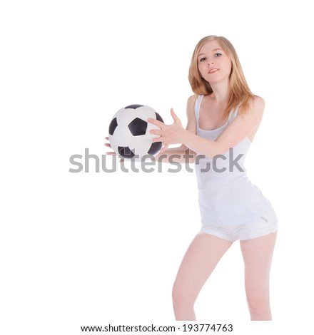 Young caucasian female with soccer ball on white background - stock photo