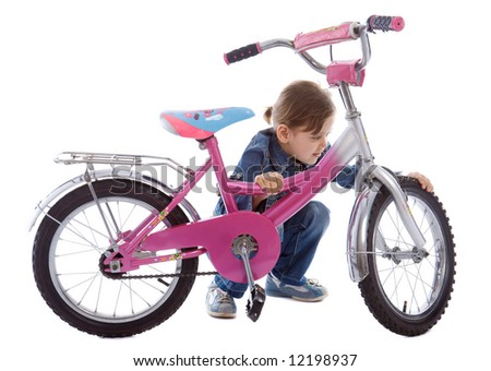 Young caucasian girl repair her bike isolated on white - stock photo
