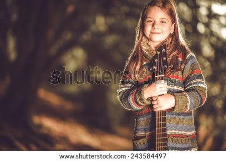 Young Caucasian Girl with Classic Acoustic Guitar in Hands. Musician Girl Portrait. - stock photo