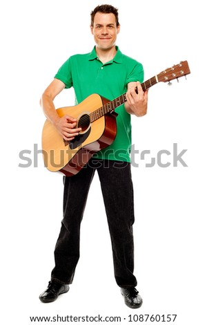 Young caucasian guitarist playing tracks isolated over white background - stock photo