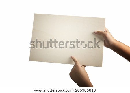 Young caucasian hands holding a light color plywood square blank signboard isolated on white background. Index finger is pointing the sign. There are no elements to distract viewer from reading - stock photo