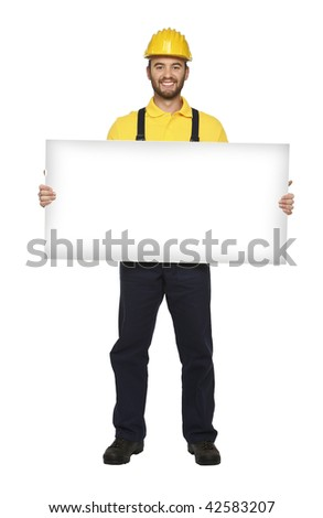 young caucasian handyman hold white board isolated - stock photo