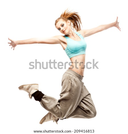 young caucasian hip-hop dancer woman showing some jumps - stock photo