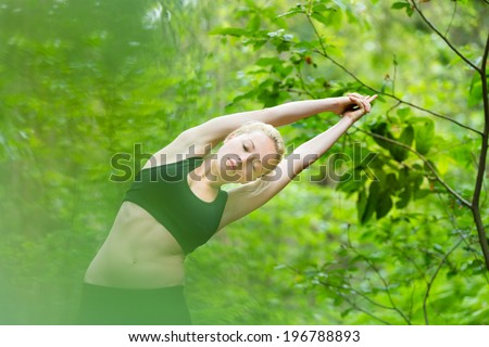 young caucasian lady is practicing half moon yoga pose in