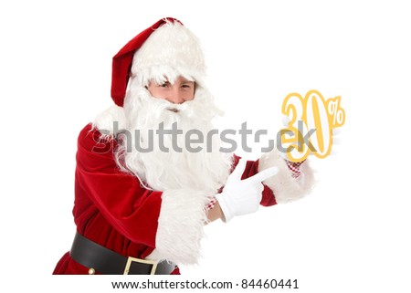 Young caucasian man in Santa Claus clothes pointing at thirty percent discount sign. Studio shot. White background. - stock photo