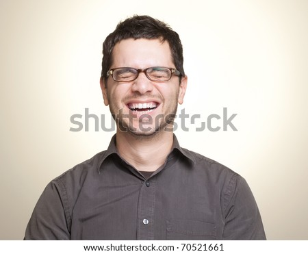 Young caucasian man with glasses laughing - stock photo