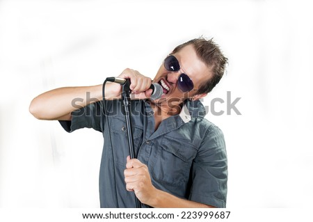 Young caucasian rock singer on the white background - stock photo