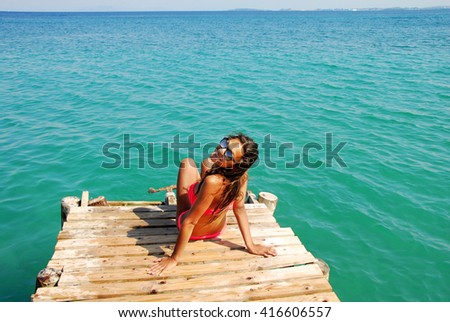 young Caucasian teenage girl on the wooden pier by blue Ionian sea, Greece - stock photo