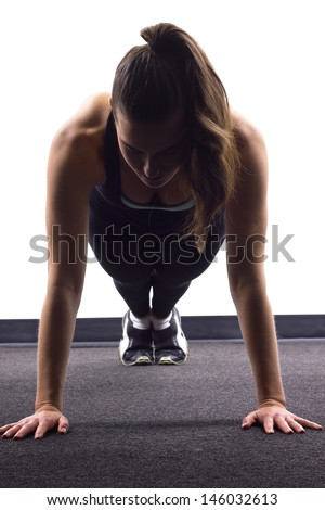 young Caucasian woman doing push ups - stock photo