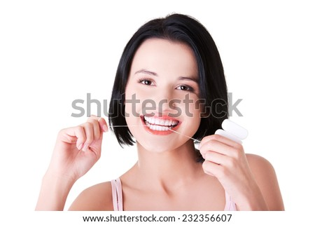 Young caucasian woman flossing her teeth. - stock photo