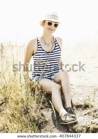 Young caucasian woman in a sailor outfit posing in outdoor. Tourism theme. - stock photo