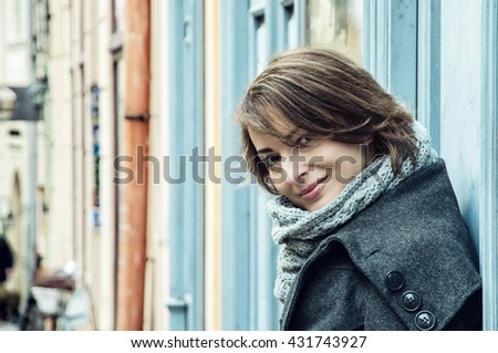 Young caucasian woman in love is leaning on the retro wall in Banska Stiavnica. Beauty and fashion. Female portrait. - stock photo