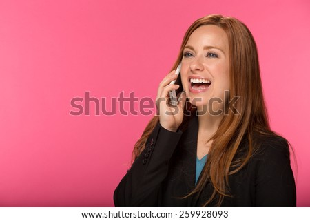 Young Caucasian woman in studio talking on cell phone - stock photo