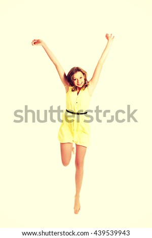 Young caucasian woman jumping - stock photo