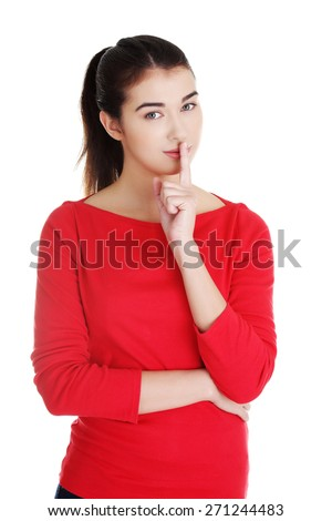 Young caucasian woman making silence sign. - stock photo