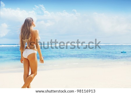 Young caucasian woman near ocean beach, bali - stock photo