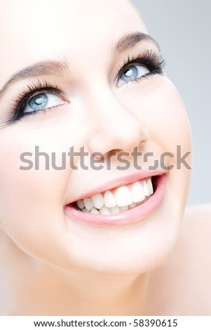 young caucasian woman smiling happily, beauty shot - stock photo