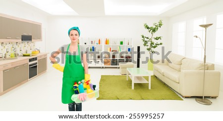 young caucasian woman standing in clean house holding cleaning products - stock photo
